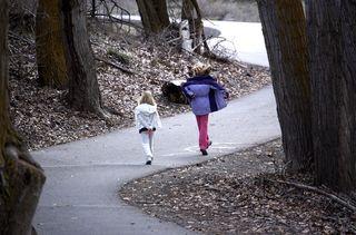 Emma and hannah walking down path
