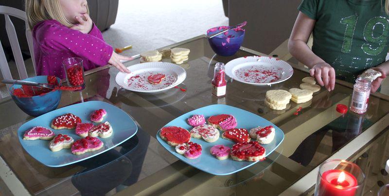 Valentines' cookies licking fingers