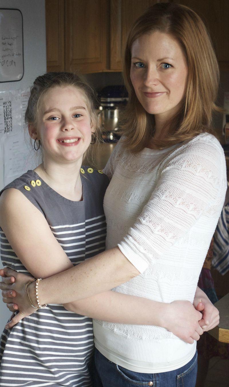 Emma hugs mom