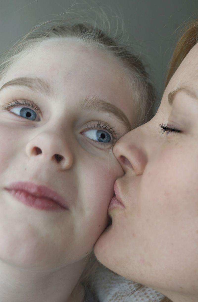 Mom kisses emma