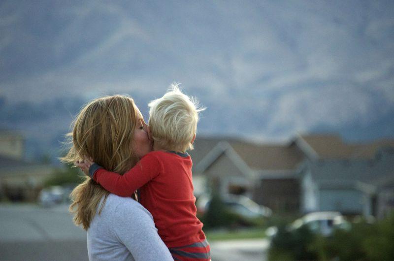 Evening walk- mom kisses ian